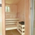 Badezimmer Sauna mit Fenster - Innenansicht, Saunabank, Saunaofen