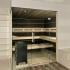 Sauna in Mooreiche mit Eckverglasung - Ansicht von vorn