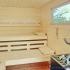 Gartensauna mit Glas und Vorraum - Einrichtung: Saunaofen mit Kräuterschale, Fenster